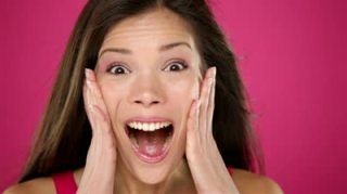 stock-footage-surprised-excited-happy-woman-closeup-portrait-of-beautiful-young-woman-with-ecstatic-face