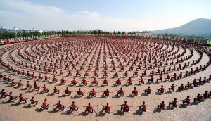 ZHENGZHOU, CHINA - JUNE 09: Thousands of students at Tagou Kung fu School play a Kung fu performance on June 9, 2012 in Zhengzhou, China.  PHOTOGRAPH BY China Foto Press / Barcroft Media  UK Office, London. T +44 845 370 2233 W www.barcroftmedia.com  USA Office, New York City. T +1 212 796 2458 W www.barcroftusa.com  Indian Office, Delhi. T +91 11 4053 2429 W www.barcroftindia.com